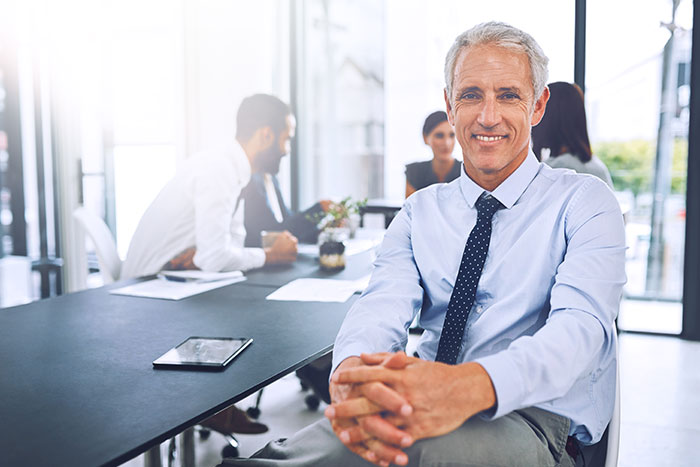 Mature businessman sitting in the office during a meeting