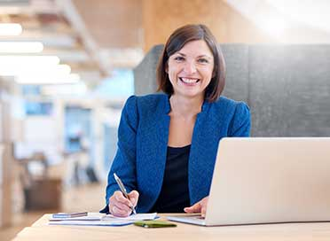 Businesswoman smiling broadly while in her office