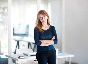 Woman smiling in an office
