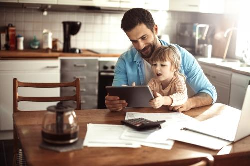 Dad playing with his daughter on an iPad