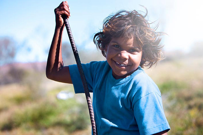 A happy indigenous girl living in outback australia