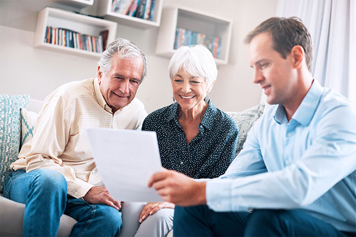 Senior couple getting advice from a financial planner