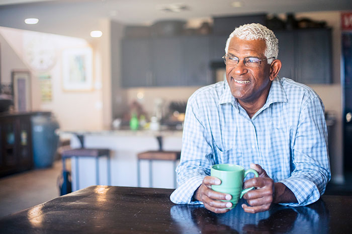 Senior african american man enjoying a cup of coffee at home